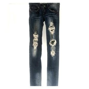 Distressed skinny machine jeans